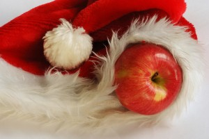 bigstock-Apple-In-Santa-Claus-Cap-3884736