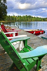 Deck Chairs On Dock At Lake